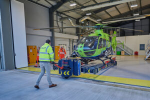 Helimed 65 being brought into the hangar